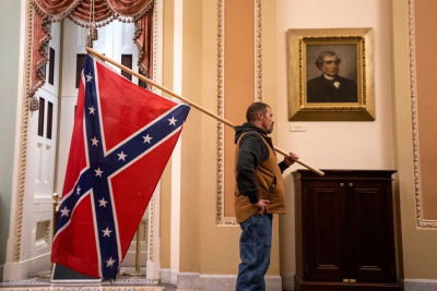 protestor carries confederate flag through U.S. Capitol